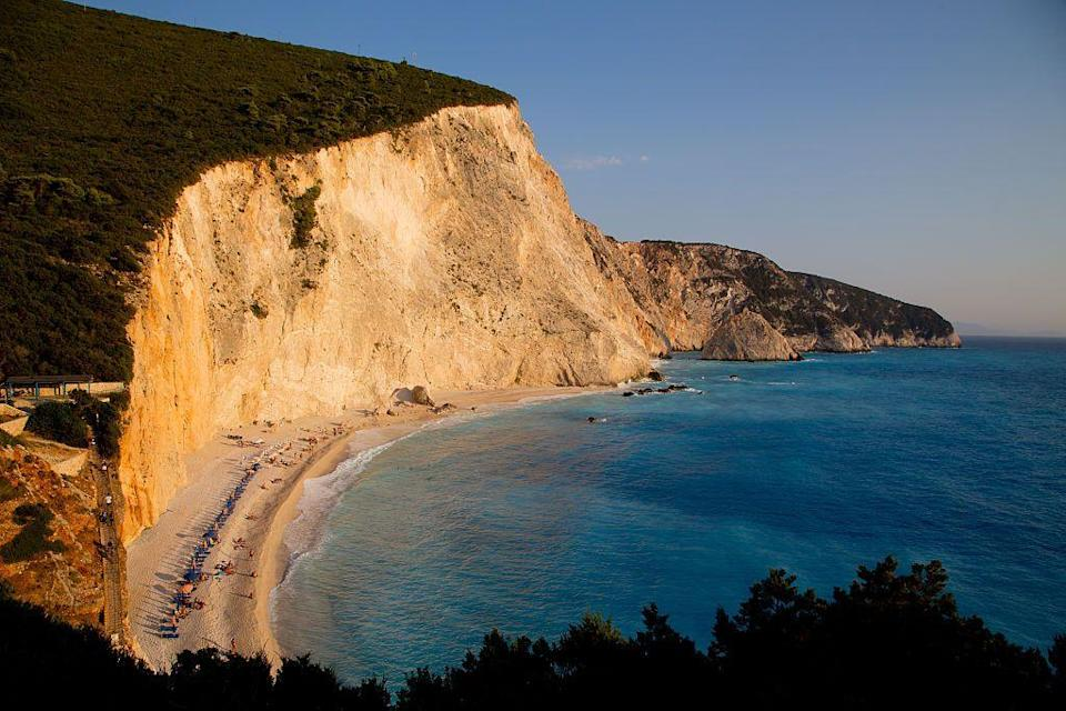 <p>Porto Katsiki is the definition of 'dramatic landscape.' The beach is sandwiched between a towering cliffside, and the ocean, and is more than worth the steps is takes to reach it.</p>