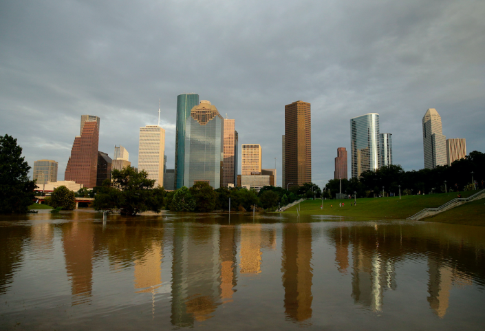 <em>Dowtown Houston is reflected in flooded Buffalo Bayou (PA)</em>