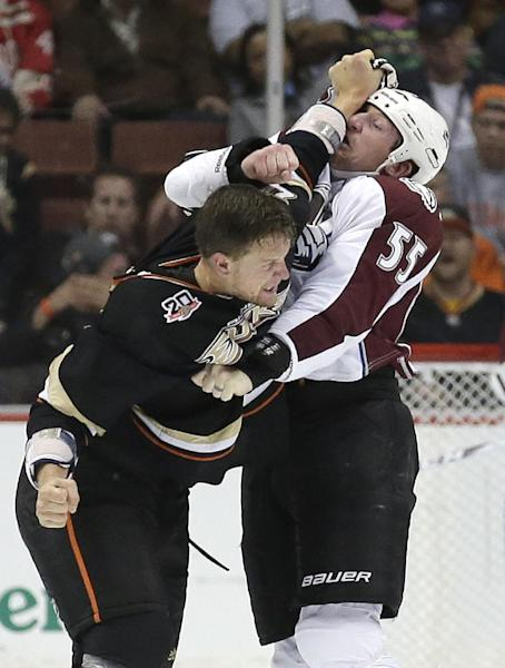 Anaheim Ducks' John Kurtz, left, fights with Colorado Avalanche's Cody McLeod during the first period of an NHL preseason hockey game in Anaheim, Calif., Sunday, Sept. 22, 2013. (AP Photo/Chris Carlson)