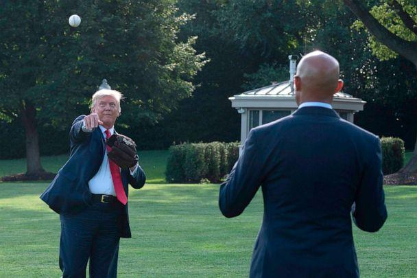 PHOTO:President Donald Trump plays ball with Mariano Rivera, the MLB Hall of Fame closer from the Yankees, during a Major League Baseball Opening Day event at the White House, July 23, 2020. (Jim Watson/AFP via Getty Images)