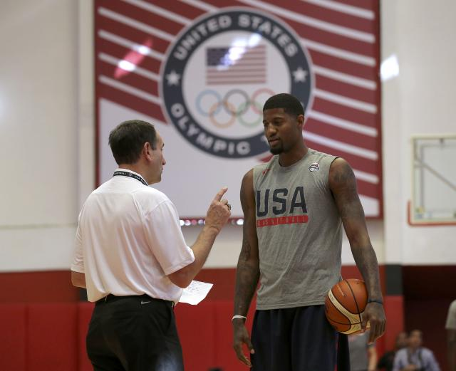 2016 Rio Olympics - Basketball - Preliminary - USA men's training session - Flamengo Club - Rio de Janeiro, BrazilHead coach Mike Krzyzewski speaks to Paul George (USA) of the U.S. during training. REUTERS/Jim Young FOR EDITORIAL USE ONLY. NOT FOR SALE FOR MARKETING OR ADVERTISING CAMPAIGNS.