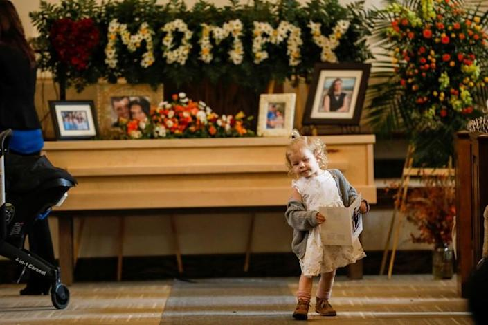 A relative of Christina Marie Langford Johnson, who was killed by unknown assailants, is pictured during her funeral service before a burial at the cemetery in LeBaron, Chihuahua
