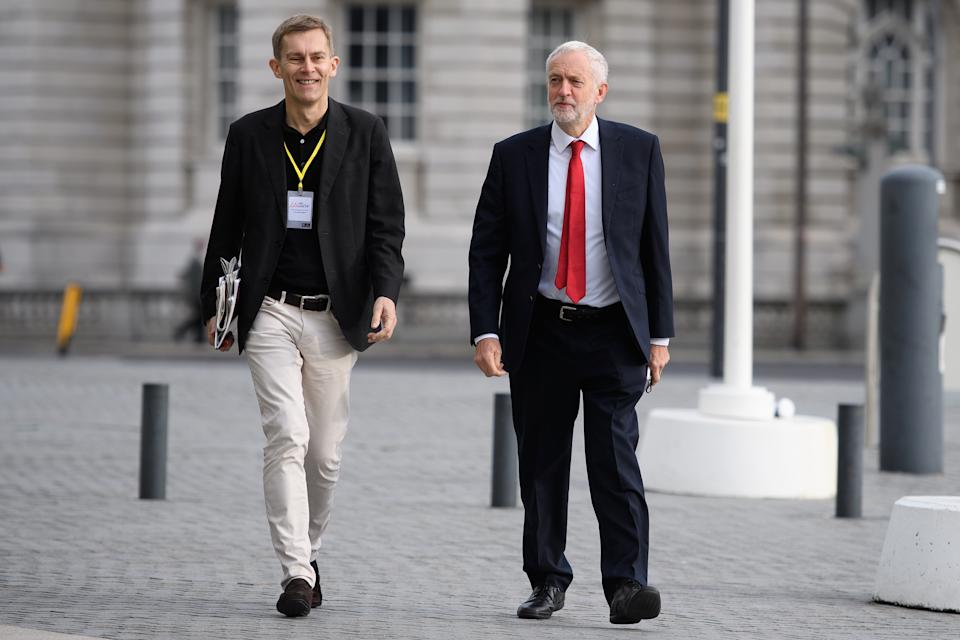 """LIVERPOOL, ENGLAND - SEPTEMBER 23: Labour Party leader Jeremy Corbyn (R) and Labour strategist Seumas Milne arrive ahead of an appearance on the Andrew Marr politics programme near the ACC Liverpool during the first day of the annual Labour Party conference on September 23, 2018 in Liverpool, England. Labour's annual conference is taking place from September 23 - September 26, held under the official slogan """"Rebuilding Britain, for the many, not the few"""".  (Photo by Leon Neal/Getty Images)"""