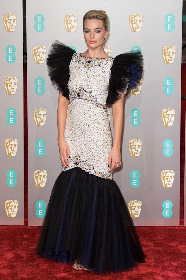 <p>in Chanel and Jimmy Choo.</p>