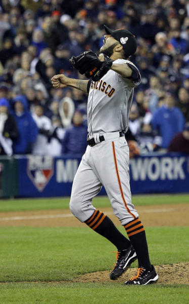 San Francisco Giants relief pitcher Sergio Romo reacts after Game 4 of baseball's World Series against the Detroit Tigers Sunday, Oct. 28, 2012, in Detroit. (AP Photo/David J. Phillip)