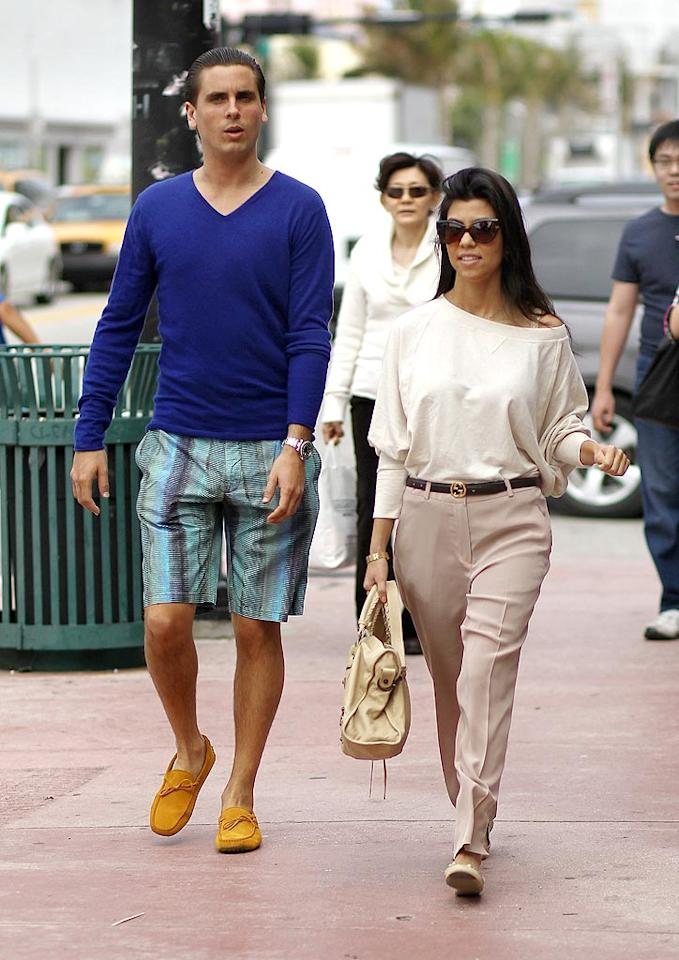 """It's hard to believe, but the Kardashian sisters spent New Year's Eve apart ... all in the name of a paycheck of course! Kourtney Kardashian was spotted out and about in Miami with her baby daddy Scott Disick before hosting a soiree at The Rooftop at The Gansevoort Hotel in Miami, while her little sis Kim debuted her new single at Tao nightclub in Las Vegas. It certainly pays to be a Kardashian! Brian Prahl/<a href=""""http://www.splashnewsonline.com/"""" target=""""new"""">Splash News</a> - December 31, 2010"""