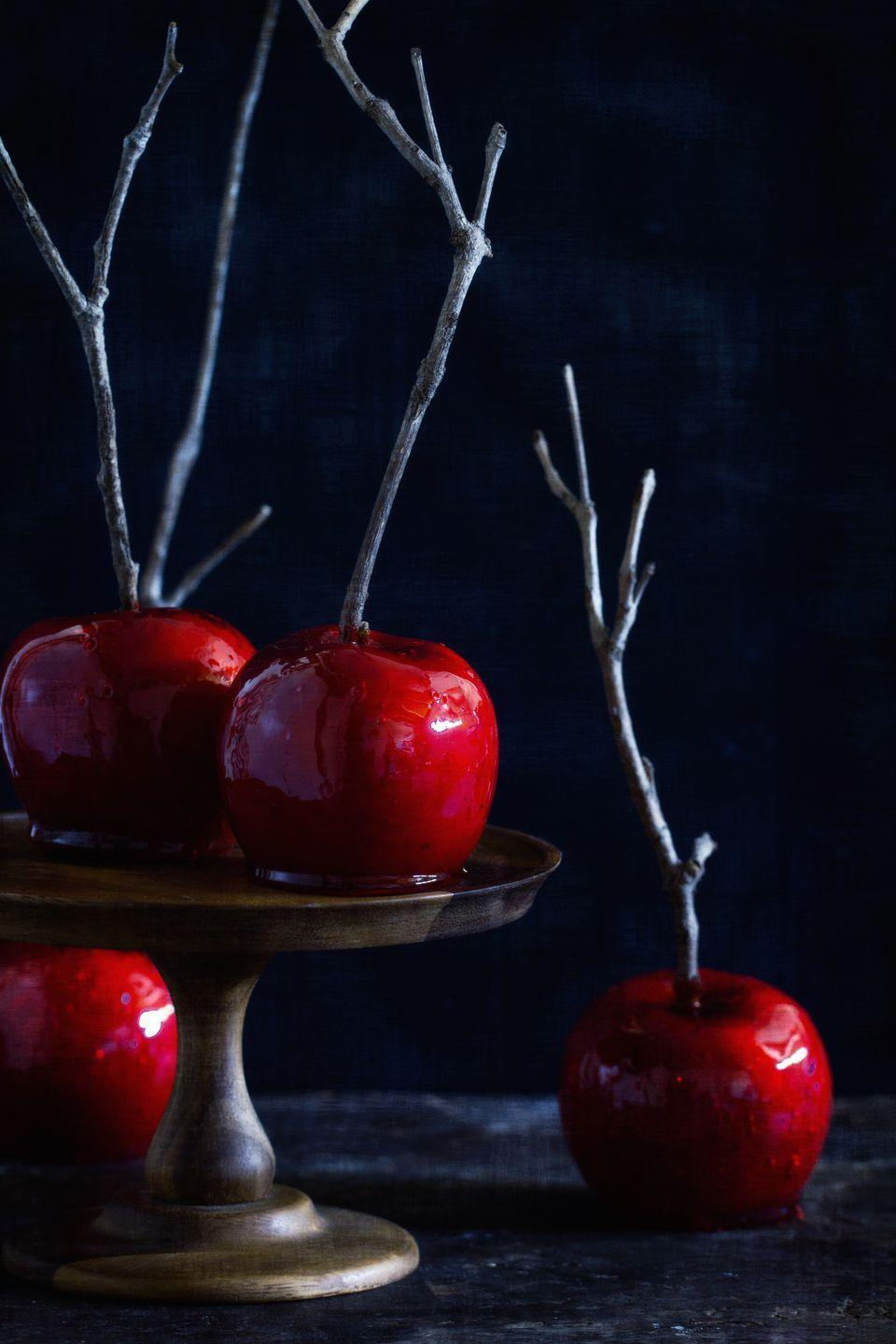"""<p>These candy apples are hot, hot, hot!</p><p>Get the recipe from <a href=""""https://www.delish.com/cooking/recipe-ideas/recipes/a43935/candied-apples-recipe/"""" rel=""""nofollow noopener"""" target=""""_blank"""" data-ylk=""""slk:Delish"""" class=""""link rapid-noclick-resp"""">Delish</a>. </p>"""