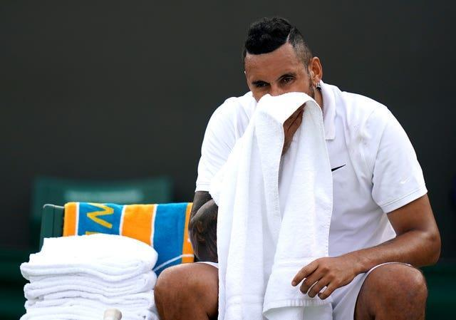 Nick Kyrgios wipes his mouth