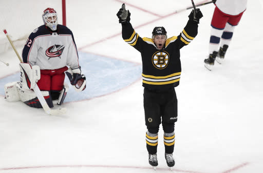 Boston Bruins center Charlie Coyle, right, celebrates after beating Columbus Blue Jackets goaltender Sergei Bobrovsky (72) for the game-winning goal during overtime of Game 1 of an NHL hockey second-round playoff series, Thursday, April 25, 2019, in Boston. The Bruins won 3-2. (AP Photo/Charles Krupa)