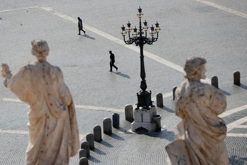 FILE PHOTO: People walk in St. Peter's Square at the Vatican