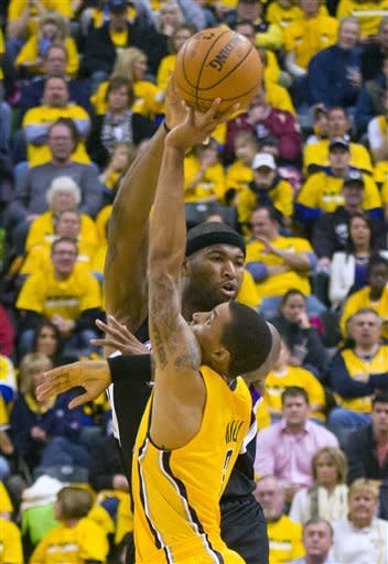 Sacramento Kings' DeMarcus Cousins gets pressure from Indiana Pacers' George Hill during the first half of an NBA basketball game in Indianapolis on Saturday, Nov. 3, 2012. (AP Photo/Doug McSchooler)
