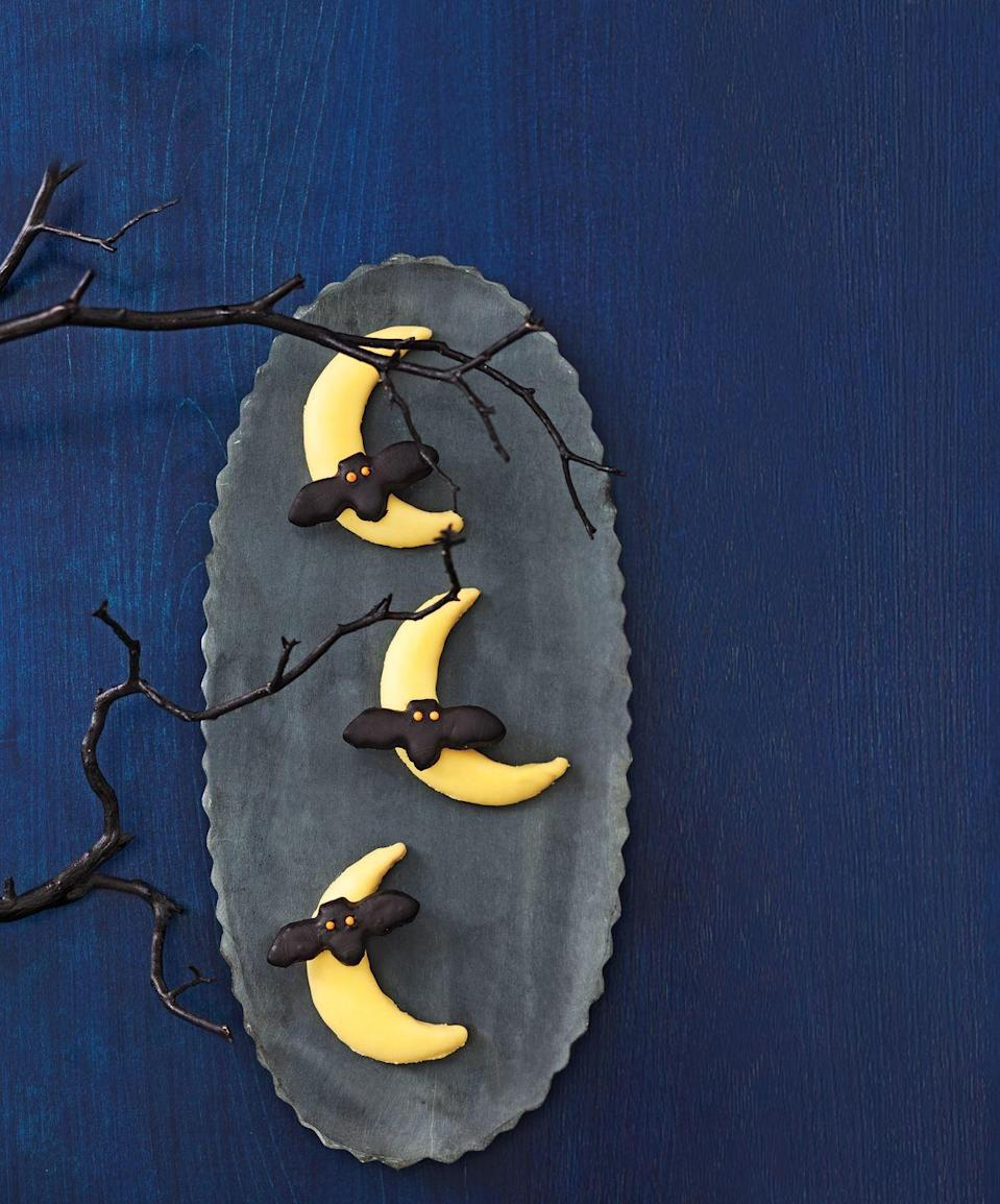 """<p>There's no reason why cookies can't serve as centerpieces. Try a fun moon shape with black bats. </p><p><a class=""""link rapid-noclick-resp"""" href=""""https://www.amazon.com/ASTRONOMY-SPECIAL-OCCASION-FONDANT-PRINTED/dp/B07FDS4H6F/?tag=syn-yahoo-20&ascsubtag=%5Bartid%7C10055.g.33437890%5Bsrc%7Cyahoo-us"""" rel=""""nofollow noopener"""" target=""""_blank"""" data-ylk=""""slk:SHOP MOON COOKIE CUTTER"""">SHOP MOON COOKIE CUTTER</a></p>"""