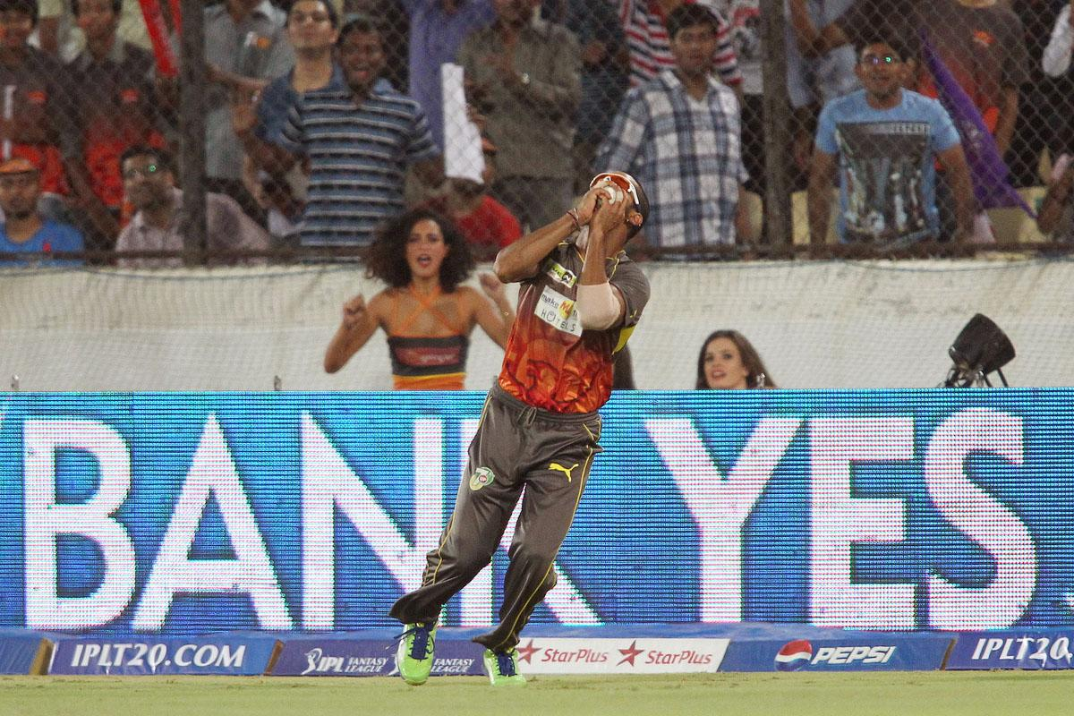 Shikhar Dhawan of Sunrisers Hyderabad takes the catch to get Jacques Kallis of Kolkata Knight Riders wicket during match 72 of the Pepsi Indian Premier League between The Sunrisers Hyderabad and The Kolkata Knight Riders held at the Rajiv Gandhi International Stadium, Hyderabad on the 19th May 2013. (BCCI)