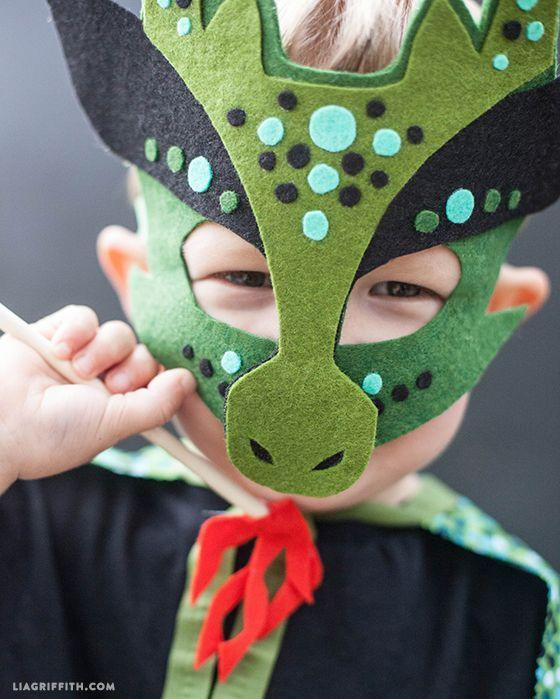 """<p>Allow your little one to become a fire-breather for the night with this wool felt dragon mask. </p><p><strong><em>Get the tutorial at <a href=""""https://liagriffith.com/homemade-halloween-costumes-no-sew-dragon-mask-and-cape/"""" rel=""""nofollow noopener"""" target=""""_blank"""" data-ylk=""""slk:Lia Griffith"""" class=""""link rapid-noclick-resp"""">Lia Griffith</a>. </em></strong></p>"""