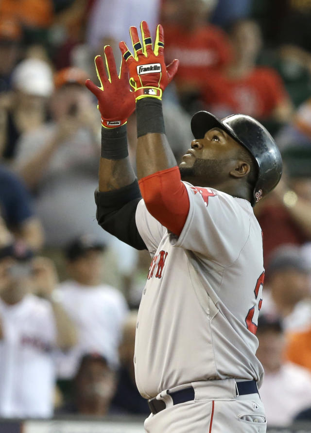 Boston Red Sox's David Ortiz gestures skyward as he crosses home plate after hitting a solo home run against the Houston Astros in the fourth inning of a baseball game Saturday, July 12, 2014, in Houston. (AP Photo/Pat Sullivan)