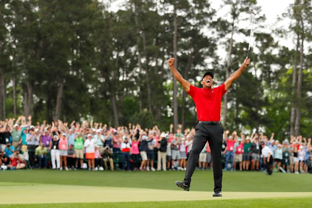 Woods celebrated amid jubilant scenes on the 18th green. (Credit: Getty Images)