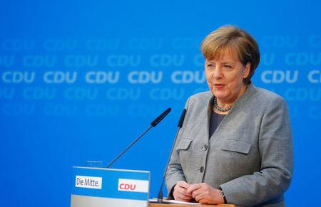 Merkel's conservatives, SPD to start talks on new govt January 7