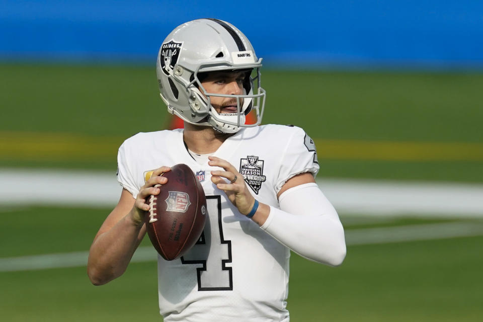 Las Vegas Raiders quarterback Derek Carr looks to throw a pass during the first half of an NFL football game against the Los Angeles Chargers, Sunday, Nov. 8, 2020, in Inglewood, Calif. (AP Photo/Ashley Landis)