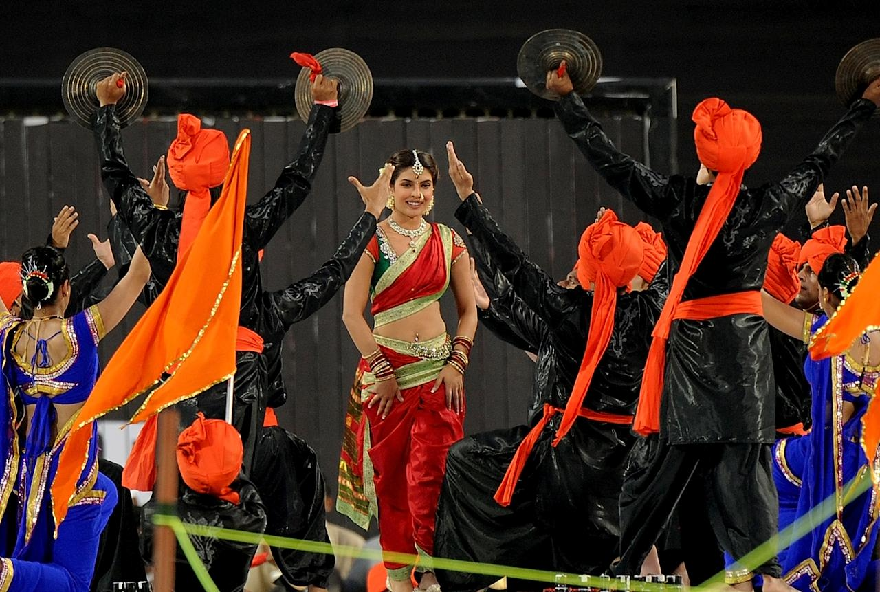 Bollywood actress Priyanka Chopra (C) performs during a ceremony before the IPL Twenty20 cricket match between Pune Warriors India and Kings XI Punjab at The Subrata Roy Sahara Stadium in Pune on April 8, 2012.