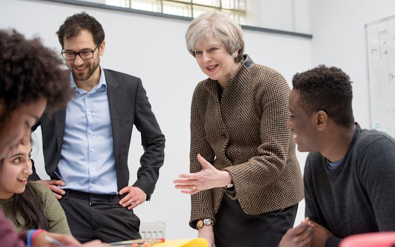 Prime Minister Theresa May talks with students at King's College London Mathematics School in central London - Credit: Victoria Jones/PA