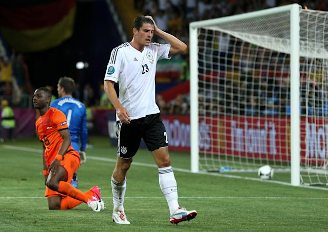 KHARKOV, UKRAINE - JUNE 13: Mario Gomez of Germany celebrates scoring their second goal during the UEFA EURO 2012 group B match between Netherlands and Germany at Metalist Stadium on June 13, 2012 in Kharkov, Ukraine. (Photo by Ian Walton/Getty Images)