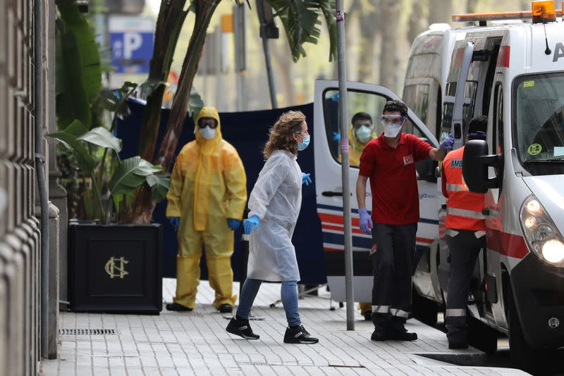 Medical workers are seen outside the Cotton House Hotel in Barcelona