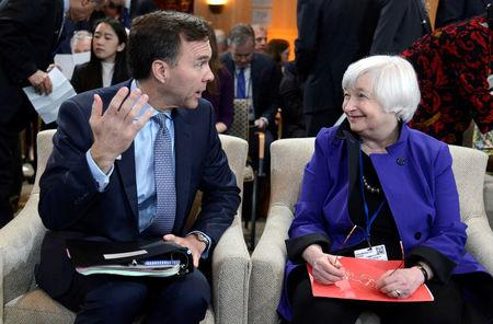 Canada's Finance Minister Bill Morneau (L) chats with Federal Reserve Board Chairperson Janet Yellen before the start of the International Monetary and Financial Committee (IMFC) meeting, as part of the IMF and World Bank's 2017 Annual Spring Meetings, in Washington, U.S., April 22, 2017.   REUTERS/Mike Theiler