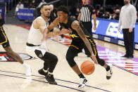 VCU's Josh Banks, right, drives the baseline past St. Bonaventure's Dominick Welch during the second half of an NCAA college basketball championship game for the Atlantic Ten Conference tournament Sunday, March 14, 2021, in Dayton, Ohio. (AP Photo/Jay LaPrete)