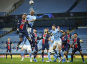 PSG's Neymar, left, challenges Manchester City's Fernandinho during the Champions League semifinal second leg soccer match between Manchester City and Paris Saint Germain at the Etihad stadium, in Manchester, Tuesday, May 4, 2021. (AP Photo/Dave Thompson)