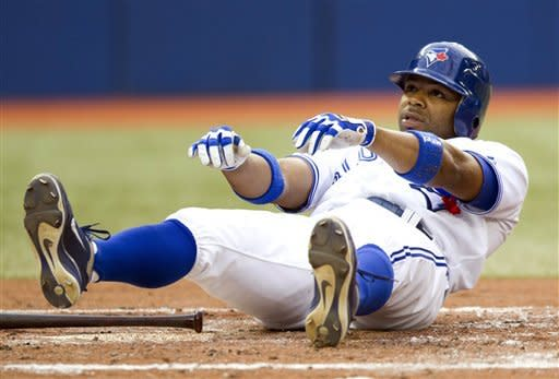 Toronto Blue Jays' Rajai Davis dusts himself off after an inside pitch from Baltimore Orioles starter Jason Hammel during the third inning of a baseball game, Wednesday, May 30, 2012, in Toronto. (AP Photo/The Canadian Press, Frank Gunn)