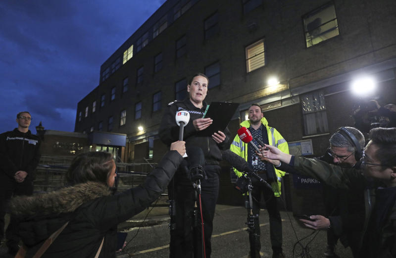 Deputy Chief Constable Pippa Mills speaks to the media during a press conference at Grays Police Station in Essex Friday, Oct. 25, 2019, after a man and a woman, both aged 38 and from Warrington, have been arrested on suspicion of manslaughter and conspiracy to traffic people in connection with the 39 bodies found in a lorry in Essex on Wednesday. ( Jason Roberts/PA via AP)