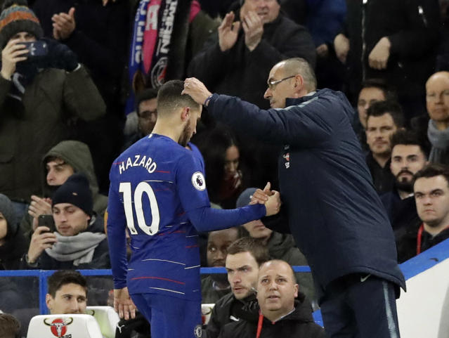 Chelsea head coach Maurizio Sarri, right, salutes Chelsea's Eden Hazard who leaves the pitch after a substitution during the English Premier League soccer match between Chelsea and Newcastle United at Stamford Bridge stadium in London, Saturday, Jan. 12, 2019. (AP Photo/Matt Dunham)