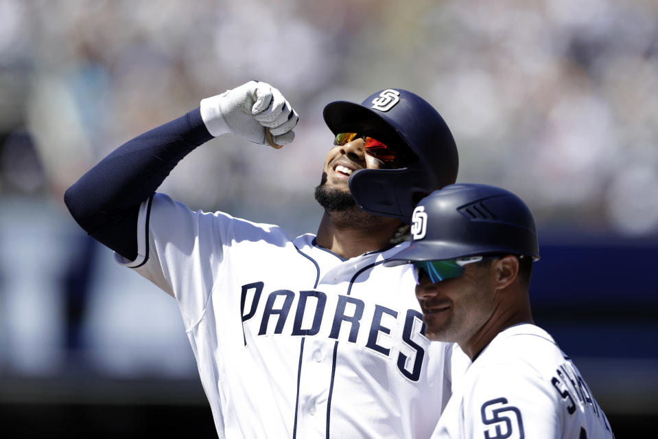 San Diego Padres' Fernando Tatis Jr. reacts after hitting a single in his first at-bat of his major leagues career, during the second inning of a baseball game against the San Francisco Giants, Thursday, March 28, 2019, in San Diego. (AP Photo/Gregory Bull)