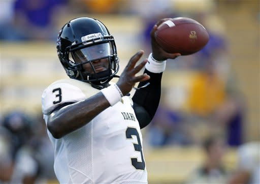 Idaho quarterback Dominique Blackman (3) warms up before before their NCAA college football game against LSU in Baton Rouge, Saturday, Sept. 15, 2012. (AP Photo/Gerald Herbert)