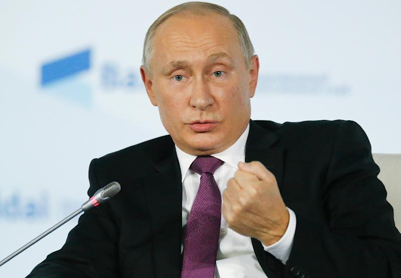 Russian President Vladimir Putin gestures as he speaks during the annual Valdai club conference of international experts in Sochi on October 19, 2017