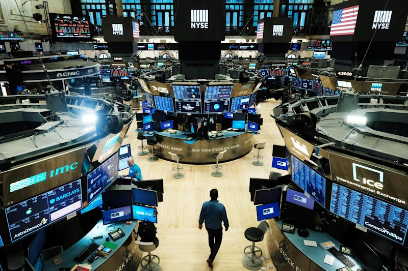 Trading on the floor of the New York Stock Exchange is now fully electronic to protect employees from spreading the coronavirus. The market had its worst first quarter since the 2008 global financial crisis: Photo by Spencer Platt/Getty Images