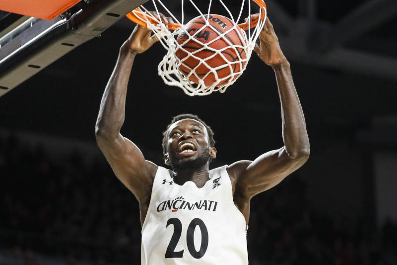 Cincinnati's Mamoudou Diarra dunks during the second half of an NCAA college basketball game against East Carolina, Sunday, Jan. 19, 2020, in Cincinnati. (AP Photo/John Minchillo)