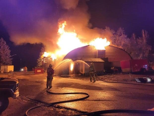 A photo posted on Facebook shows a blaze Friday night at the Moosehead Inn, which was a fixture in Kenosee Lake. (Kent Brown/Facebook - image credit)