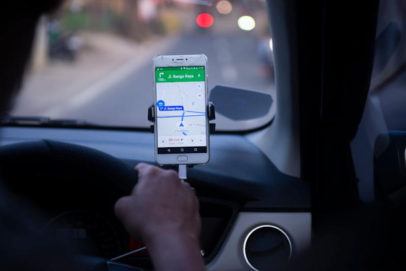 Hands-free devices like this one are required to be touching your mobile phone while driving.