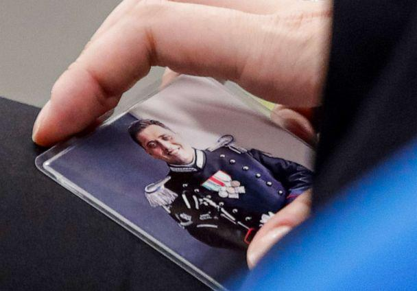 PHOTO: Rosa Maria Esilio holds a photograph of her late husband, Italian police officer Mario Cerciello Rega, in a courtroom in Rome, Italy, on Sept. 9, 2020, ahead of a hearing for the trial in which two American tourists are accused of his murder. (Alessandra Tarantino/AP)