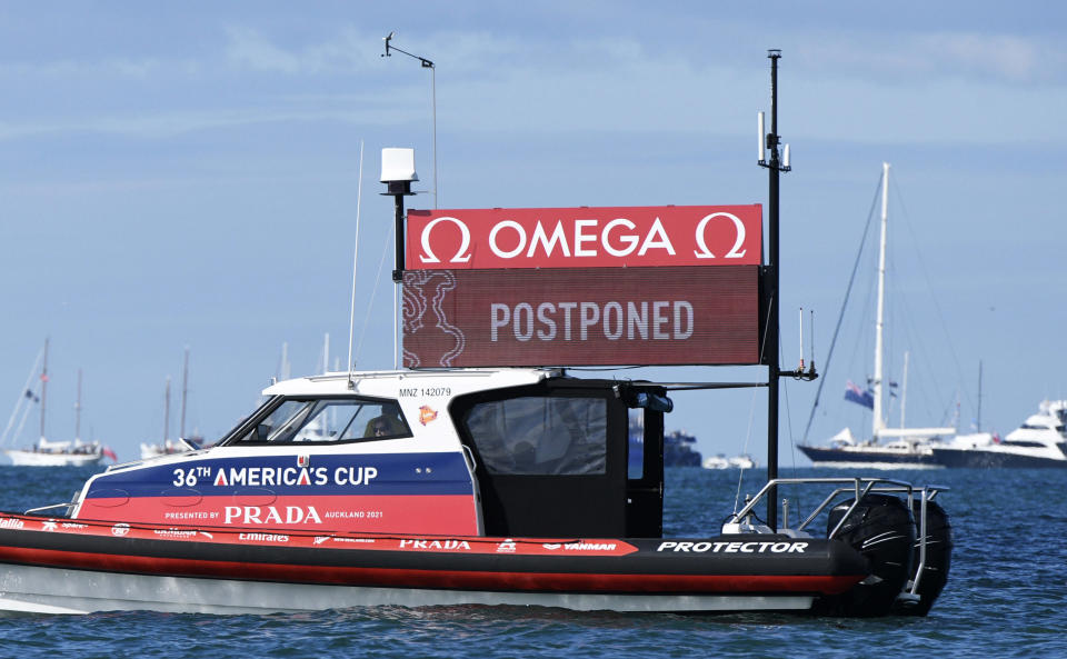 An official race boat displays a postponement message for race 7 between Italy's Luna Rossa and Team New Zealand in the America's Cup on Auckland's Waitemata Harbour, New Zealand, Sunday, March 14, 2021. (Chris Cameron/Photosport via AP)
