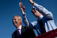 British politician Nigel Farage (L) smiles as US President Donald Trump speaks during a Make America Great Again rally at Phoenix Goodyear Airport October 28, 2020, in Goodyear, Arizona. (Photo by Brendan Smialowski / AFP) (Photo by BRENDAN SMIALOWSKI/AFP via Getty Images)