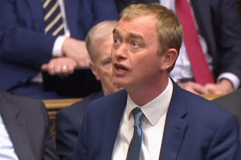 Tim Farron speaking during Prime Ministers questions in the House of Commons (AFP/Getty Images)