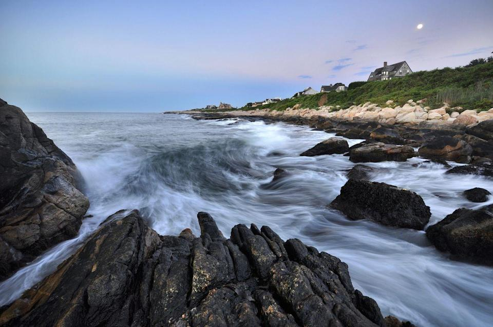 <p>Rocks surround Narragansett Bay, located on the north side of Rhode Island. Tourists visit the seaside town for its warm-water beaches.</p>