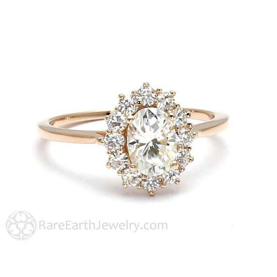 """<i><a href=""""https://www.etsy.com/listing/194958365/18k-cluster-moissanite-engagement-ring?ga_search_query=moissanite&ref=shop_items_search_1"""" target=""""_blank"""">Buy it from RareEarth on Etsy</a> for$1,195.</i>"""