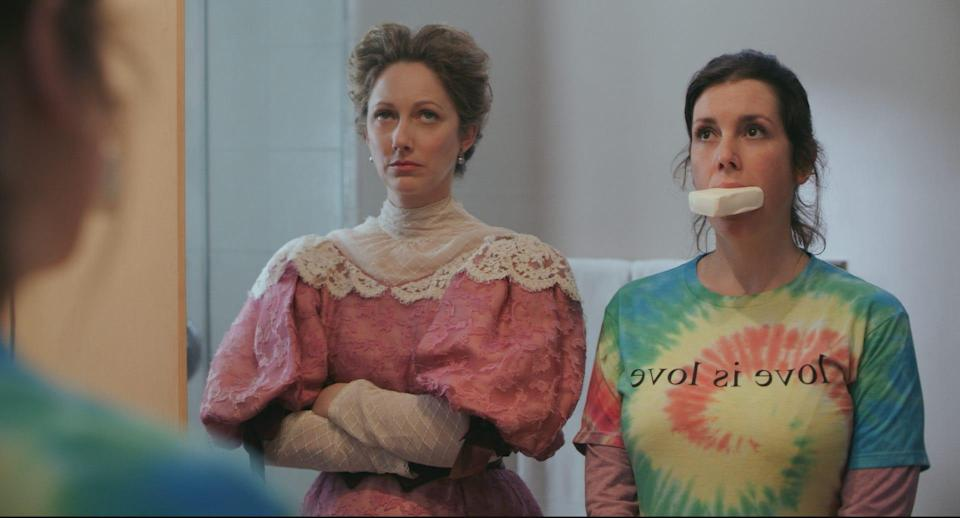 """Ghostly Lady Wadsworth (Judy Greer, left) tries to rid Hannah (Melanie Lynskey) of her foul mouth in the comedy """"Lady of the Manor."""""""