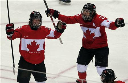 Canada's Marie-Philip Poulin (L) celebrates her gold medal-winning overtime goal against Team USA with teammate Hayley Wickenheiser at the Sochi 2014 Winter Olympic Games February 20, 2014. REUTERS/Laszlo Balogh
