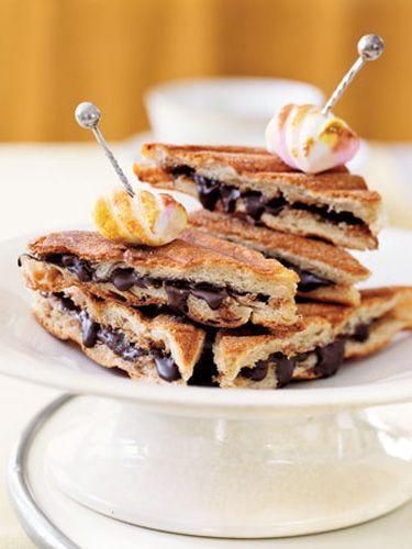 """<p>Mom won't be able to resits these ciabatta slices filled with nut butter and the best eating chocolate you can fin. Grill until it melts into a swoon-inducing balance of crunchy and smooth. Crown the dreamy concoction with a toasted marshmallow. </p><p><strong><a href=""""https://www.countryliving.com/food-drinks/recipes/a840/chocolate-hazelnut-panini-15/"""" rel=""""nofollow noopener"""" target=""""_blank"""" data-ylk=""""slk:Get the recipe"""" class=""""link rapid-noclick-resp"""">Get the recipe</a>.</strong><br></p>"""