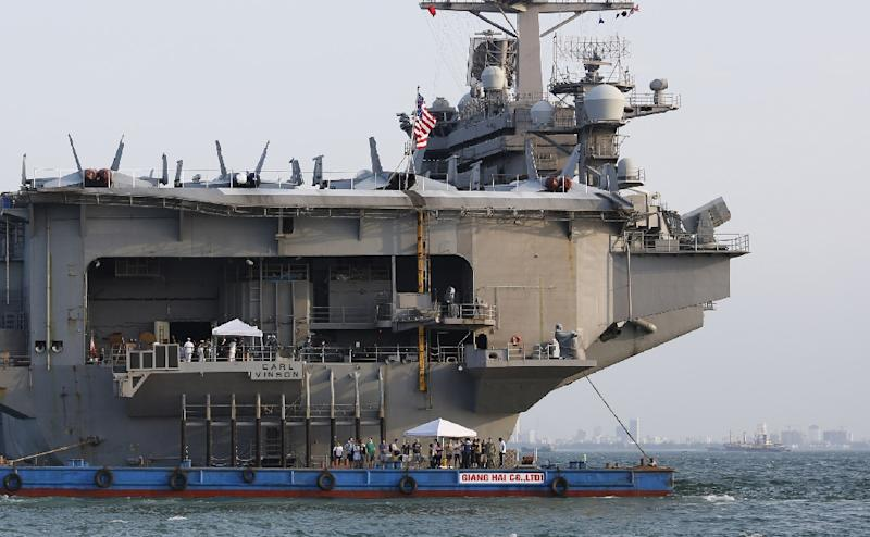 A barge is seen attached to the stern of the US aircraft carrier USS Carl Vinson anchored off the coast in Danang, Vietnam (AFP Photo/Truong GIANG)