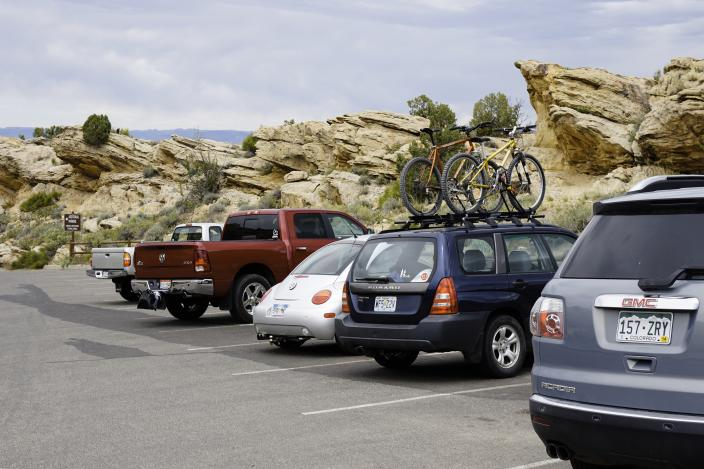 Cars of visitors parked at the Colorado National Monument, a National Park in southwest Colorado. (Photo:Getty Images)